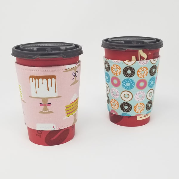 Reusable cup cozy displayed on two medium coffee cups to display both prints - Sweet Treats