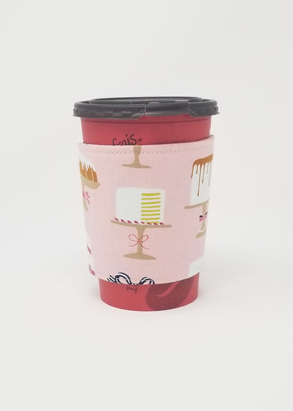 Reusable cup cozy displayed on a medium coffee cup - Sweet Treats