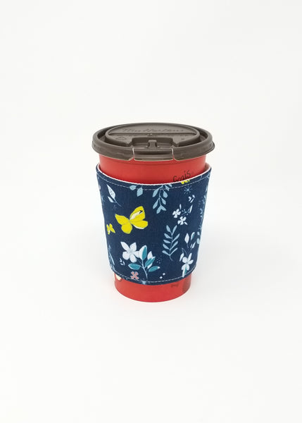 Reusable cup cozy displayed on a medium Tim Horton's coffee cup - Navy Butterflies and Flowers