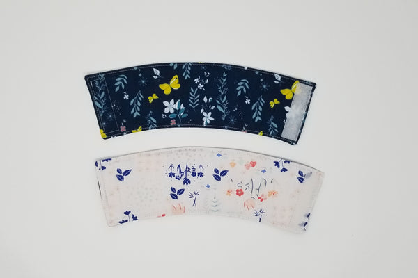 Reusable cup cozy front and back - Navy butterflies and flowers on the front, flowers and mushrooms on the back
