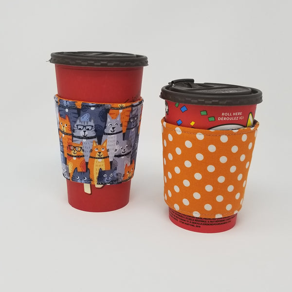 Reusable cup cozy displayed on a large and medium coffee cup - Orange Kitties