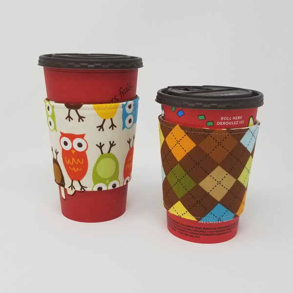 Reusable cup cozy displayed on a large and medium coffee cup - Owls and Argyle