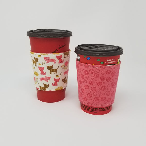 Reusable cup cozy displayed on a large and medium coffee cup - Pink Kittens