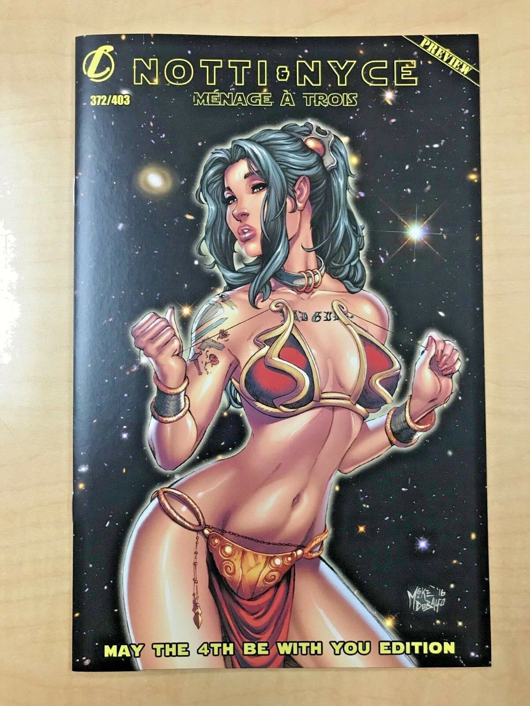 Notti & Nyce Preview May The 4th Be With You Slave Leia Variant by Mike Debalfo