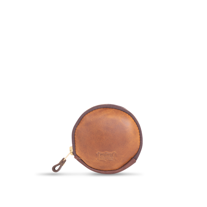 Orox Leather Co. handcrafted circular pouch with high quality luxury craftsmanship made to last a lifetime, made for men and women to stay organized and travel in fashion.