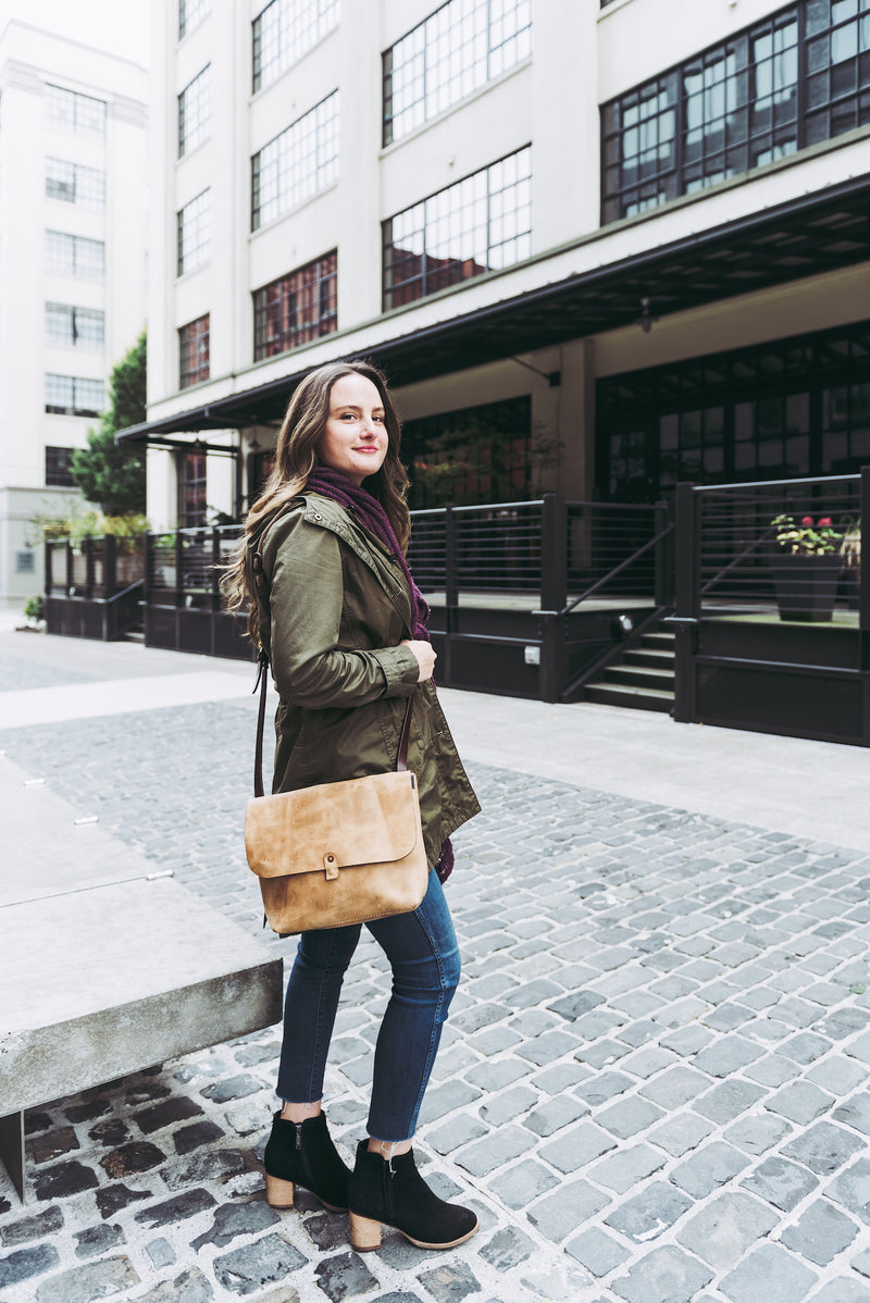 Orox Leather Co. handcrafted leather crossbody satchel with high quality luxury craftsmanship made to last a lifetime, made for men and women to stay organized and travel in fashion.