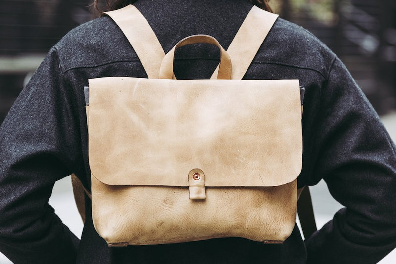 Orox Leather Co. handcrafted leather satchel backpack with high quality luxury craftsmanship made to last a lifetime, made for men and women to stay organized and travel in fashion.
