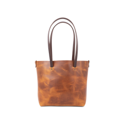 Orox Leather Co. handcrafted leather tote with high quality luxury craftsmanship made to last a lifetime, made for men and women to stay organized and travel in fashion.