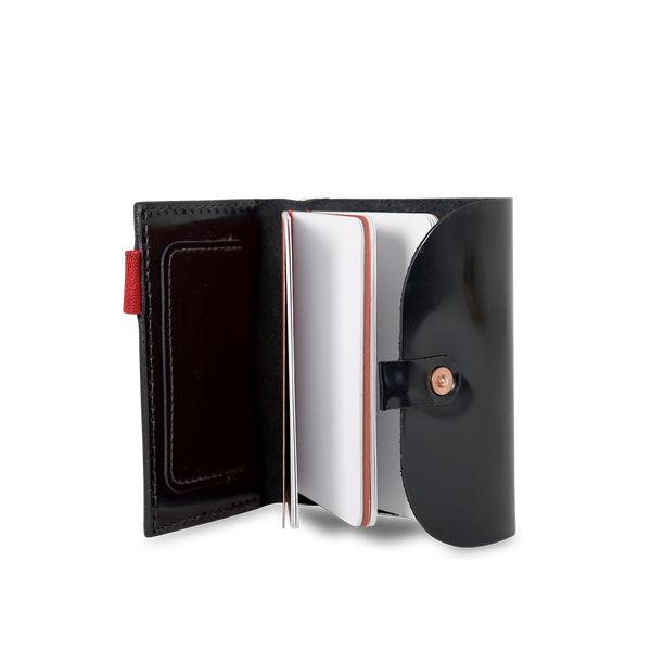 Hand crafted shiny leather notebook accessory with high quality luxury craftsmanship made to last a lifetime, made for men and women to stay organized and travel in fashion.
