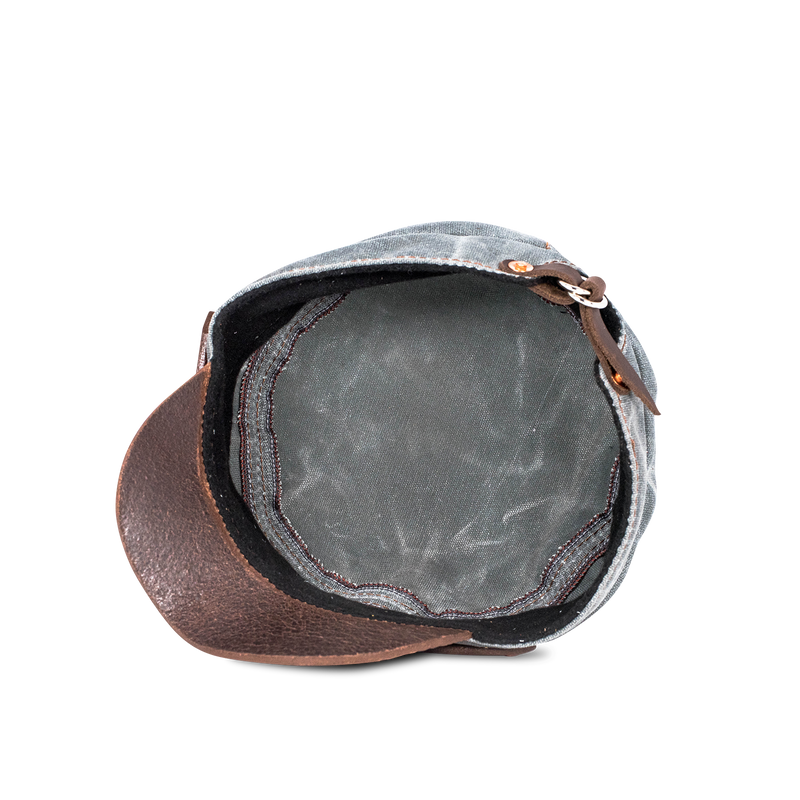 Hand crafted leather and canvas hat with high quality luxury craftsmanship made to last a lifetime, made for men and women who travel and adventure in fashion.