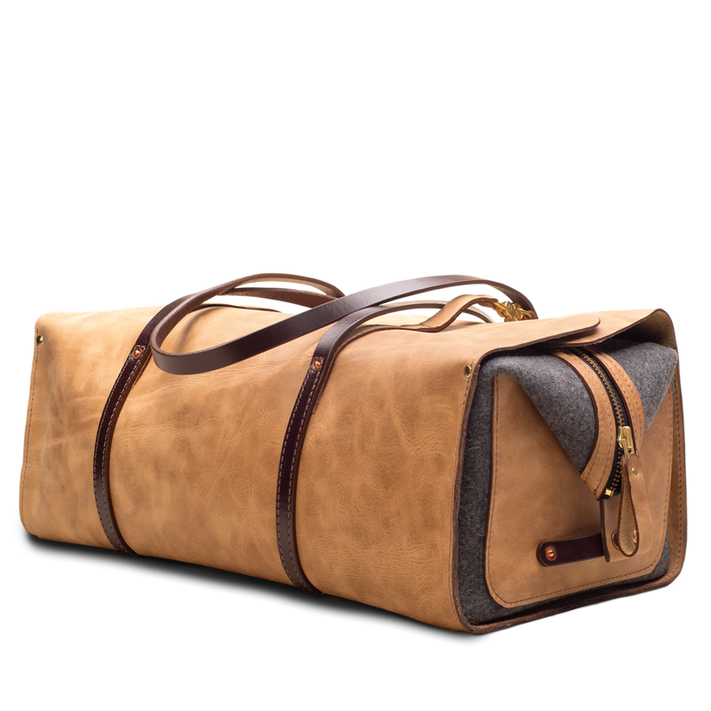 Hand crafted leather duffel bag with high quality luxury craftsmanship made to last a lifetime, made for men and women to stay organized and travel in fashion.
