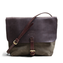 Hand crafted leather can canvas crossbody satchel purse with high quality luxury craftsmanship made to last a lifetime, made for women  who travel in fashion.