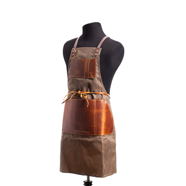 Hand crafted leather and canvas apron with high quality luxury craftsmanship made to last a lifetime, made for men and women woodworkers, builders, grillers, cooks, and gardeners.