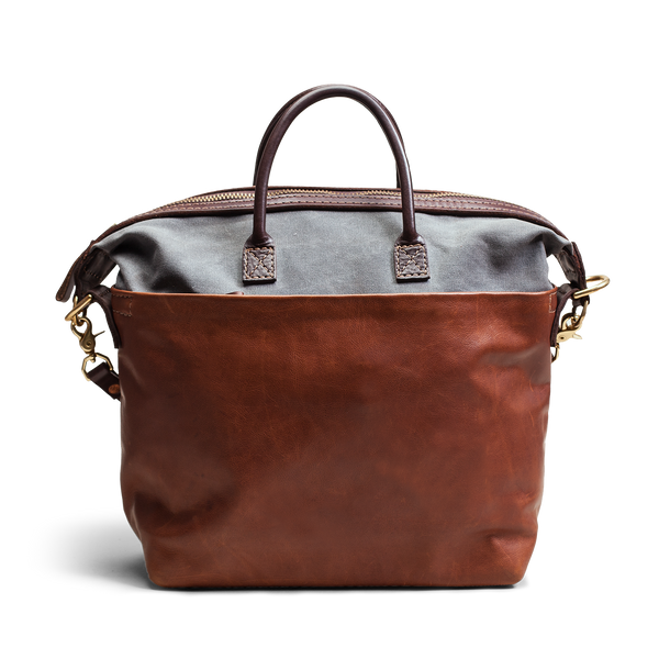 Hand crafted leather and canvas satchel messenger bag with high quality luxury craftsmanship made to last a lifetime, made for men and women business professionals who travel in fashion.
