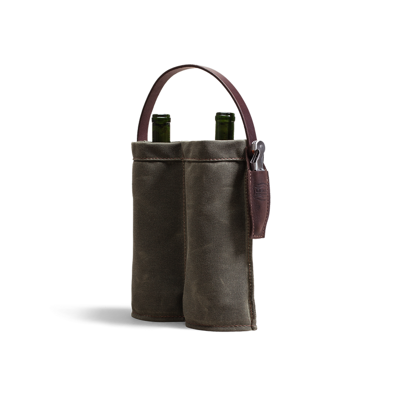 Hand crafted leather and canvas wine carrier accessory with high quality luxury craftsmanship made to last a lifetime, a great gift or keepsake for those who love wine.