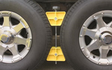 "Camco RV Wheel Stop- Stabililizes Your Trailer by Securing Tandem Tires to Prevent Movement While Parked- 26"" to 30"" Tires- Small (44652)"