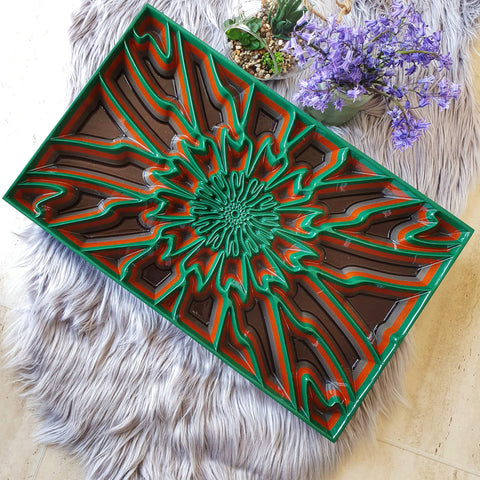 Wood wall art panel with green and brown colours made with wood. The geometric design in carved deeply into the wood creating a modern artwork.