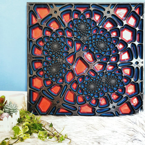 Wood wall art panel with grey and red colours made with wood. The geometric design in carved deeply into the wood creating a modern artwork.