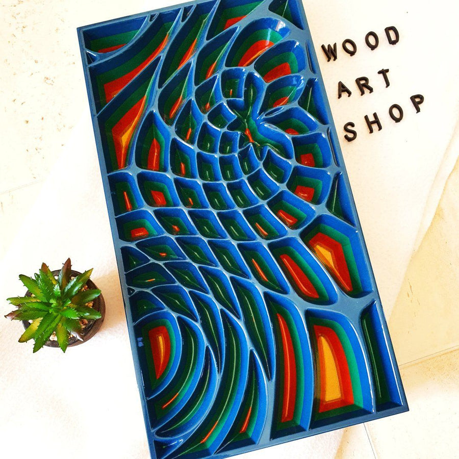 Geometric wood wall art created with Valchromat as wood material. Front view of the carved wall art