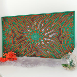 Wood wall art sculpture created with Valchromat as wood material. Front view of the carved wall art