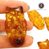 Cognac Amber Handmade Carved Owl with Skull Cabochons