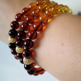 Baltic amber gradient color round beads bracelet