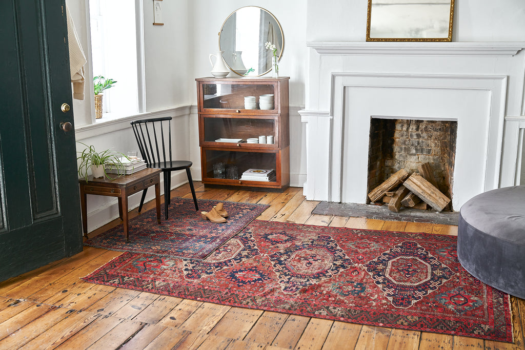 Vintage Persian rugs on an antique pine floor