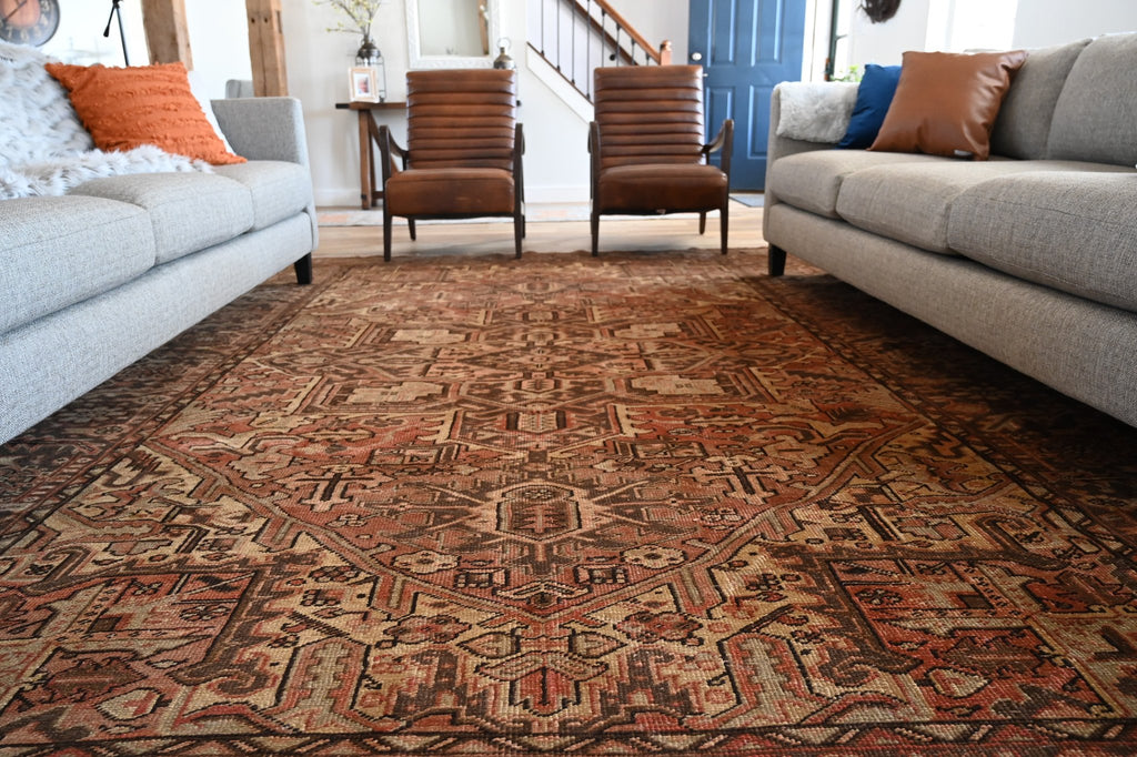 A large vintage rug in a living room.