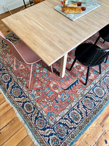 Tables and Chairs on Antique Heriz Serapi area rug
