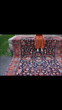 Load image into Gallery viewer, sitting on vintage Persian Heriz Serapi Rug