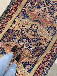 Standing on Antique Rug
