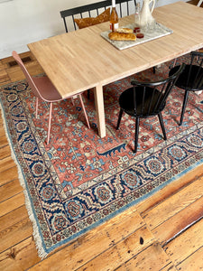table and chairs on area rug