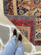 Load image into Gallery viewer, standing next to Antique Caucasian Zekhur Kuba rug