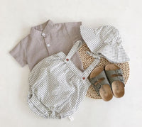 Boys romper set. Three piece set complete with a shirt, romper and matching hat. 0-24 months boys clothing at Bel Bambini baby boutique. Baby boy and toddler boys stylish outfits feom everyday wear to special occasions.