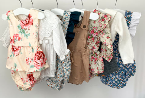 Variety of girls rompers from the Bel Bambini collection