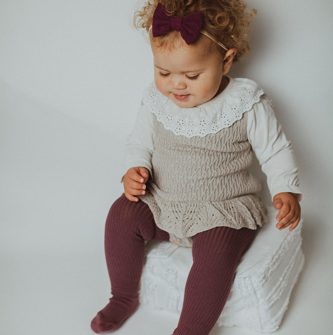 baby and toddler knitted clothing for autumn winter. Beautiful baby knitted styles for boys and girls aged 0-24m. Shop our exclusive range at Bel Bambini baby boutique.