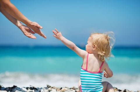Beach baby checklist, a guide of what to pack for baby and toddlers summer holiday abroad.