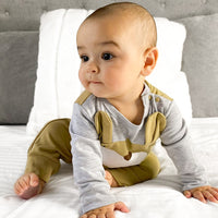 Little baby boy in our bear romper. Cute boys clothing for baby and toddler.