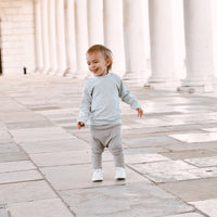 Baby boys and toddler boys autumn clothing. Sweaters, sets, rompers, sleepsuits and leggings for boys in our baby and toddler collections at Bel Bambini boutique.