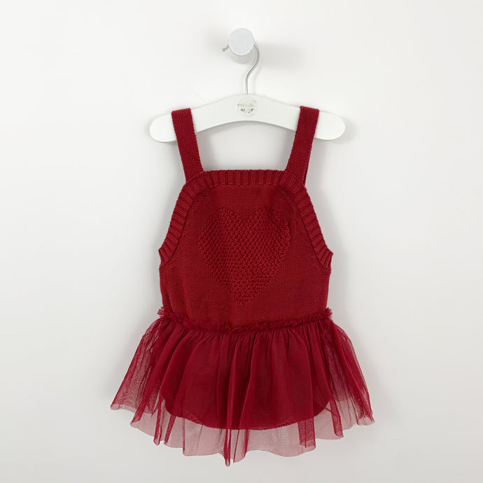 Red knitted romper for babies and toddlers with a mesh tutu skirt.  Red knitted styles for baby girls and toddler girls. Perfect for a Christmas outfit, layer with a pretty long sleeve top or cute cardigan. Knitted romper with tutu skirt.