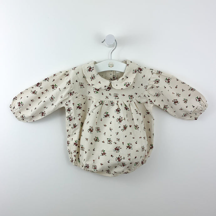 Peter pan collar romper for baby girls and toddlers. age 0-24 months, this is a beautiful romper with a pretty floral print,  shop our girls clothing collections for babies and toddlers online today at Bel Bambini baby boutique.