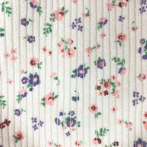 Ditsy floral detail shot from our corduroy romper from our spring girls collection.