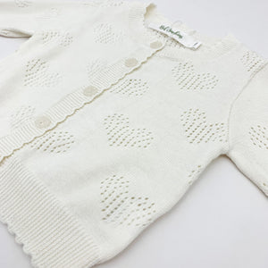 Heart detail openwork cotton knitted cardigan. Baby girls and toddlers need a lightweight summer cardigan for thiose cool evenings to keep warm. Long sleeve knitted cardigan in our new collection of spring summer baby clothing.