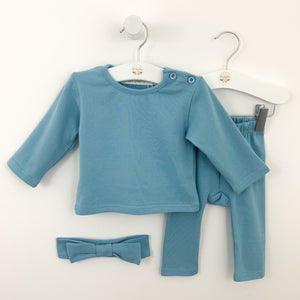 Loungewear set for baby girls available in soft blue or sugar pink. Set comes complete with a headband, long sleeve tee and leggings. Baby girls cotton rich lounge set is perfect for playing and days at nursery or chilling at home.