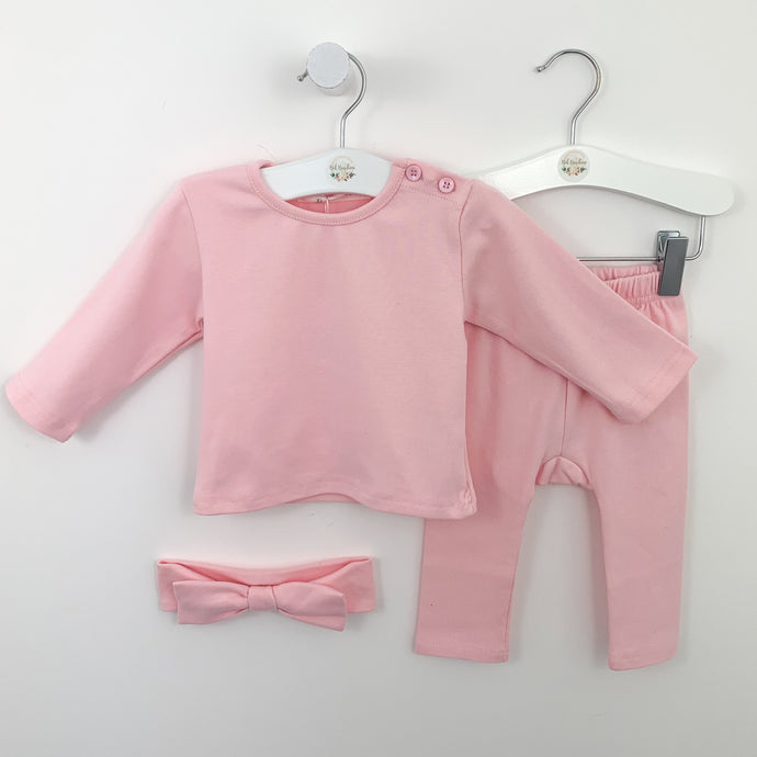 Loungewear set for baby girls aged 0-24 months in sugar pink. Set comes complete with a long sleeve top, leggings and a headband that all match. Button fastenings to the neck and elasticated waist on the leggings.
