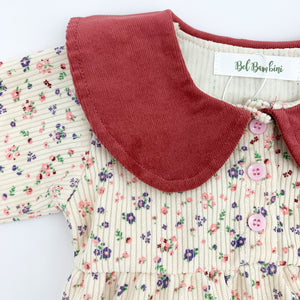 Peter pan collar features on our baby girls romper. Flower print makes up this outfit for baby and toddler girls 0-2 years.