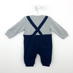 Back shot showing the criss cross style back detail and pocket on the bum. Long sleeves, soft and comfortable baby clothing for boys.