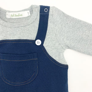Baby and toddler boys dungaree romper. Popper fastenings and button dtails to the straps. Pocket to the centre front. Available in grey and denim.