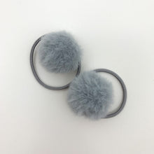 Load image into Gallery viewer, Grey bobbles for girls. Our fluffy pompom bobbles are so dreamy and perfect for styling your little girls hair. Elasticated band for toddler girls and baby girls hair.