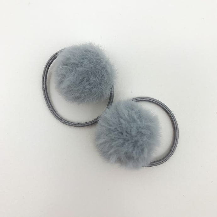 Grey bobbles for girls. Our fluffy pompom bobbles are so dreamy and perfect for styling your little girls hair. Elasticated band for toddler girls and baby girls hair.